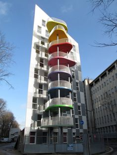 "Each unit in this social housing building outside of Paris has its own uniquely-colored, flower-shaped terrace, designed as an ""extra room"" with just enough space for 8 people to sit around a table or for a few hammocks to be hung up."