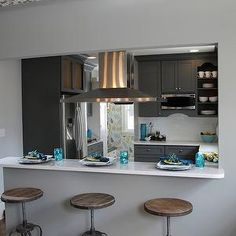 If we open the kitchen up, we'll need a ceiling mounted range hood.