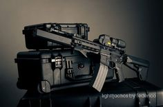 AR with Aero Precision monolithic upper, EOTech & magnifier, and Osprey can.