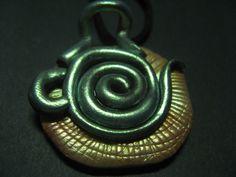 Tea pot spiral motif