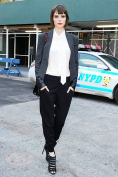 Coco in borrowed from the boys blazer and trousers. #CocoRocha #NYFW