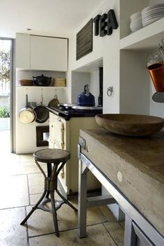 Wonderful white lived-in kitchen with reclaimed wood butcher block/counter top and an aga.