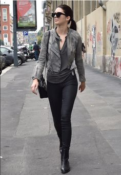 Kendall Jenner taking a stroll in black skinny jeans, a stone-washed leather jacket and a sleek ponytail.