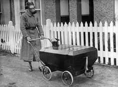 Historic images 1.) A woman taking her baby for a stroll in a gas-resistant baby carriage.