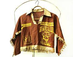 This vintage Davy Crockett boy's shirt is a 1950s Wonderland children's Halloween costume, complete with vinyl fringe!