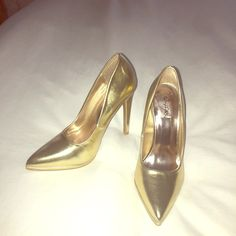 Gold pointed toe heel pumps Gold pointed toe heel pumps.  Never worn.  Perfect for NYE! I bought these to wear with a Halloween costume and didn't need them after all. Qupid Shoes Heels