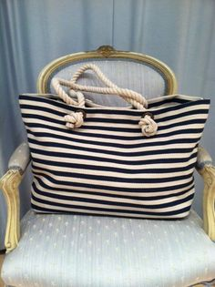 We be taking this nautical tote to the beach with us this summer!  (via @boutiika www.boutiika.com)