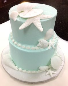 Beach themed wedding complete with a beautiful sea shell cake.