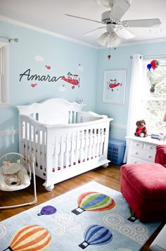 Whether it's by plane or hot air balloon, you'll want to just fly away in this happy and cheerful nursery.