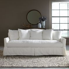 Has a different look for everything on this page -- more about comfort -- but I like the white slipcover look and think it can fit in with the more streamlined midcentury look.