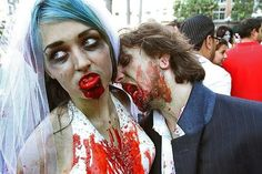 Comic-Con 2012  ( Kirk McKoy / Los Angeles Times / July 14, 2012 )  Steven Daney of Redondo Beach gives zombie bride Kristen Spenlove of San Pedro a love bite before they joined the march through San Diego's Gaslamp District.