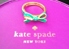 Kate Spade bow tie ring.