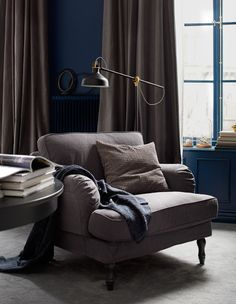 A reading area with an armchair, floor lamp and table     LOUNGING AROUND in your hotel-style bedroom all day doesn't mean you have to stay in bed. A seating area with armchairs and a table feels very hotel-like and creates a cozy reading area for a change of indoor scenery.