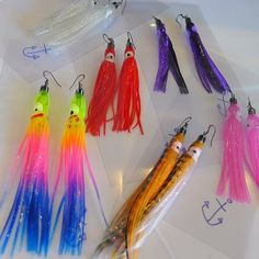 Super kawaii earrings made from bright, glittery plastic squid lures.   Light in weight but heavy in impact, these make a serious statement! These cuties are transparent with bold glittery colours running through them.