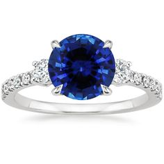 This Radiance Diamond Ring (1/3 ct. tw.) has a carat shaped Blue Sapphire with -clarity.