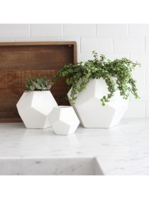 """White Faceted Vase Gorgeous geometric white vases in 3 different sizes. Makes a wonderful accent piece or a funky vase. Matte white. Dimensions: Small: 4.5""""Dia. X 4""""H Medium: 7""""Dia. X 6""""H Large: 10""""Di"""