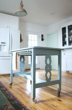 Meet my new kitchen island! I'm smitten! A friend of mine wasn't really using the table anymore and asked if I'd be interested in buying it for a project piece. The lovely details…