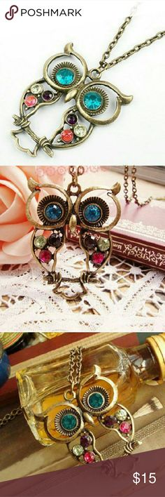 "Multi-Color Crystal in Bronze Owl Pendant Lovely Multi-Color Rhinestone Crystal in Bronze Owl Pendant.  Wonderful gift for your friends?or yourself! A wise choice for a gift?  Material: Alloy & Rhinestone?Crystals Length: 26 inches? Pendant size: 2"" x 1.75""? Jewelry Necklaces"
