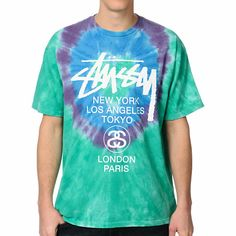 "If you're ready for spring break to arrive, be sure your clothing shows it with the white circles tie dye tee shirt from Stussy. This guys short sleeve standard fit crew neck tee features a blue, purple and green tie dye colorway meant to help spread the good vibes around the globe with call outs at the chest for ""New York, Los Angeles, Tokyo, London, Paris"". The back features the Stussy logo as well with city call outs to ""Bronx, Compton, Santa Ana, Brooklyn, Venice"". Keep the good times…"