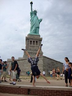 Displaying his handstand in front of the Statue of Liberty