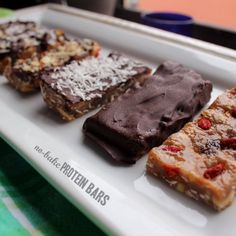 Protein Bars - No Bake and Baked Versions by quicheaweek: Per bar with raisins & goji berries, no chocolate: 154 calories // 13g carbs // 7g fat // 11g protein // 3g fiber // 4g sugar Per bar with raisins & goji berries, chocolate covered: 180 calories // 16g carbs // 9g fat // 11g protein // 5g fiber // 4g sugar Add ons: add 10-15 calories, 1g carbs, 1-2g fat, 0-1g protein or so, depending on what you're using. #Protein_Bars
