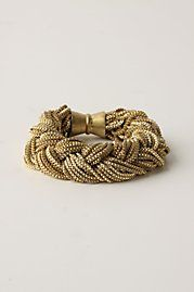 get a bunch of chains from a craft store or even broken necklaces and braid them. It's that easy!