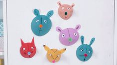 Directions for making adorable painted animal heads from paper and pom-poms.