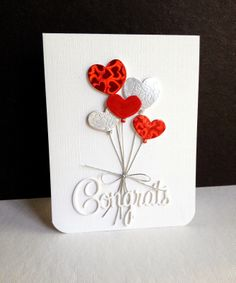 handmade congratulation card from I'm in Haven ... all die cuts ... bouquet of heart balloons in shiny red and white popped up ... CONGRATS die cut in white ... wedding card ... luv it!