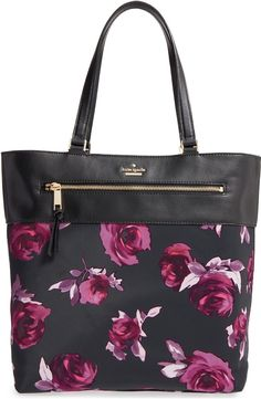 Swooning over this spacious nylon tote by Kate Spade. A chic leather trim and a gorgeous floral print make this beauty standout.