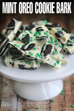 Looking for a fun and easy St. Patrick's Day inspired dessert?  Maybe something no-bake?  Check out this adorable Mint Oreo Cookie Bark made with crumbled cool mint Oreos and white chocolate sprinkled over with cute little shamrocks.