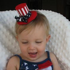 Patriotic Mini Top Hat Hair Clip in Red, White, and Blue with Blue Fabric Bow: Stars and Stripes for 4th of July. $11.00, via Etsy.
