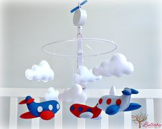 Musical airplane mobile You pick your colors by LullabyMobiles