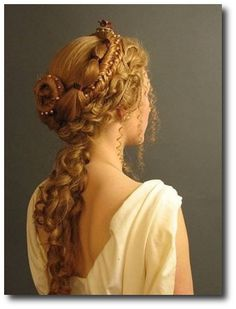 "Roman Hairstyle Perfection modeled by a potential Bride. Recent archaeological discoveries may indicate they used needles and thread to achieve the complicated braiding and beading. The word acus was  translated hairpin but Jane Stephens Baltimore, MD a hair archeologist & embroidery hobbyist questioned this. She postulated acus was being used in its original meaning ""embroidery"" to create the intricate hairstyles. This theory has gained credibility."