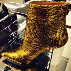 Very cool gold boot from 3.1 Phillip Lim. Check out more great products on free local shopping app Snapette - www.snapette.com/app