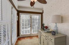 Traditional Hallway with Ceiling fan, terracotta tile floors, Carpet, flush light