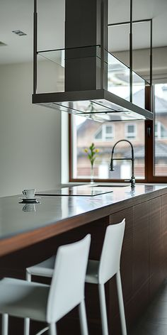 Stock photo - brown kitchen island with cooktop, sink and modern range hood over it on the brown window background. walls are light. there is a white cup Kitchen Island Hood Ideas, Kitchen Island With Cooktop, Industrial Kitchen Island, Island Cooktop, Modern Kitchen Island, Kitchen Islands, Kitchen Stove, Ikea Kitchen, Stove Range Hood