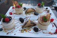 Enjoying a trio of desserts at Toronto's Osteria dei Ganzi on Jarvis Street.