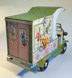 French truck 2    Made out of scrapbook paper    Laura Denison Secret Garden truck Graphic 45        see link has inst video  http://g45papers.typepad.com/graphic45/2013/05/hello-g45ers-steampunk-spells-fanciful-floral-clockworks-vintage-voyage-mechanical-marvels-nev.html