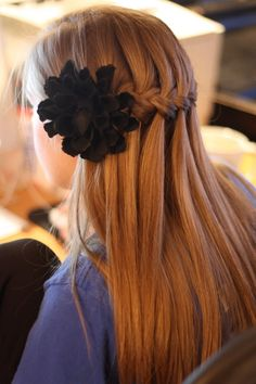 Waterfall Braid Tutorial....i love how in the front she put a flower(: