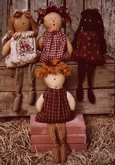 I must get this pattern!  These sweet shelf-sitters will look great anywhere in your home!  They feature long dangly legs, knotted at the  ankle, and bodies  filled with rice so they sit nicely.  Their faces are penned and their hair can be made from yarn or fabric scraps!