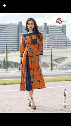 Order now devastating orange-blue front slit cut indian party wear kurti. This printed top having 3 sleeves & round neckline is best to couple with checked trouser. Salwar Designs, Kurti Neck Designs, Blouse Designs, Indian Party Wear, Indian Wear, Kurti Patterns, Dress Patterns, Fancy Kurti, Indian Designer Wear