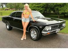 """Long-legged blonde posing with a """"66 Chevelle SS396"""