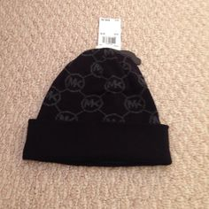 Authentic Michael Kors Hat NWT Brand new and never worn! Black with dark grey MKs MICHAEL Michael Kors Accessories Hats