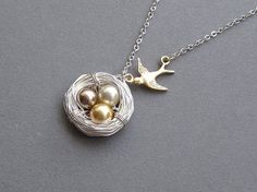 """Love the tones of these pearls. """"Mommy"""" necklace that is not too over the top."""