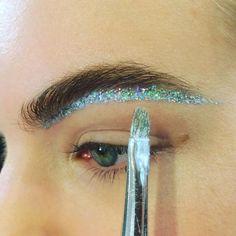 Under brow glitter.