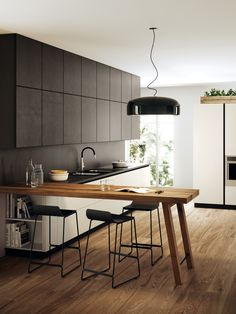 Contemporary kitchen inspiration, table benchtop against a white and black kitchen design - Found on Pinterest