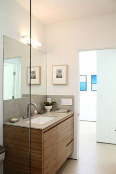 modern bath room. nice cabinet detailing; i like the walnut in horizontal grain pattern with finger pulls