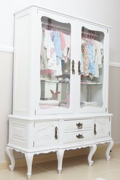 Repurpose a vintage china cabinet into a little girl's clothing armoire: just paint a pretty updated color + add rod for hanging clothes-- can use optional shelves for folded clothes or add cute storage baskets, leave glass doors uncovered or add pretty fabric. Wonder if this would work with hubby's old gun cabinet?