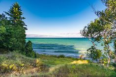 This breathtaking camping locale sits on the shores of Grand Traverse Bay and offers some of Michigan's most wonderful views. There's no better place to unwind. Camping Places, Camping Spots, Vacation Places, Places To Travel, Places To Go, Rv Camping, Camping Ideas, Glamping, Vacations In The Us