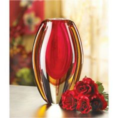 Brilliant reds and golds glow in any light bringing a burst of color to any room. Add your favorite blooms to this striking glass vase for a breathtakingly beau